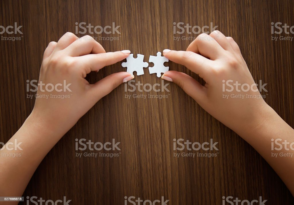 puzzle pieces on table stock photo