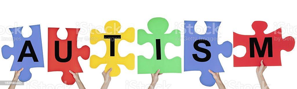 Puzzle Pieces Spelling Autism stock photo