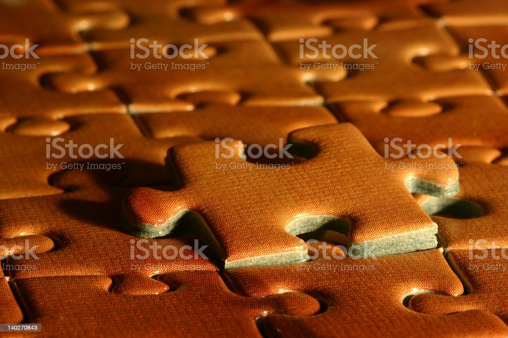 Puzzle pieces with one sticking out - concept: solution royalty-free stock photo