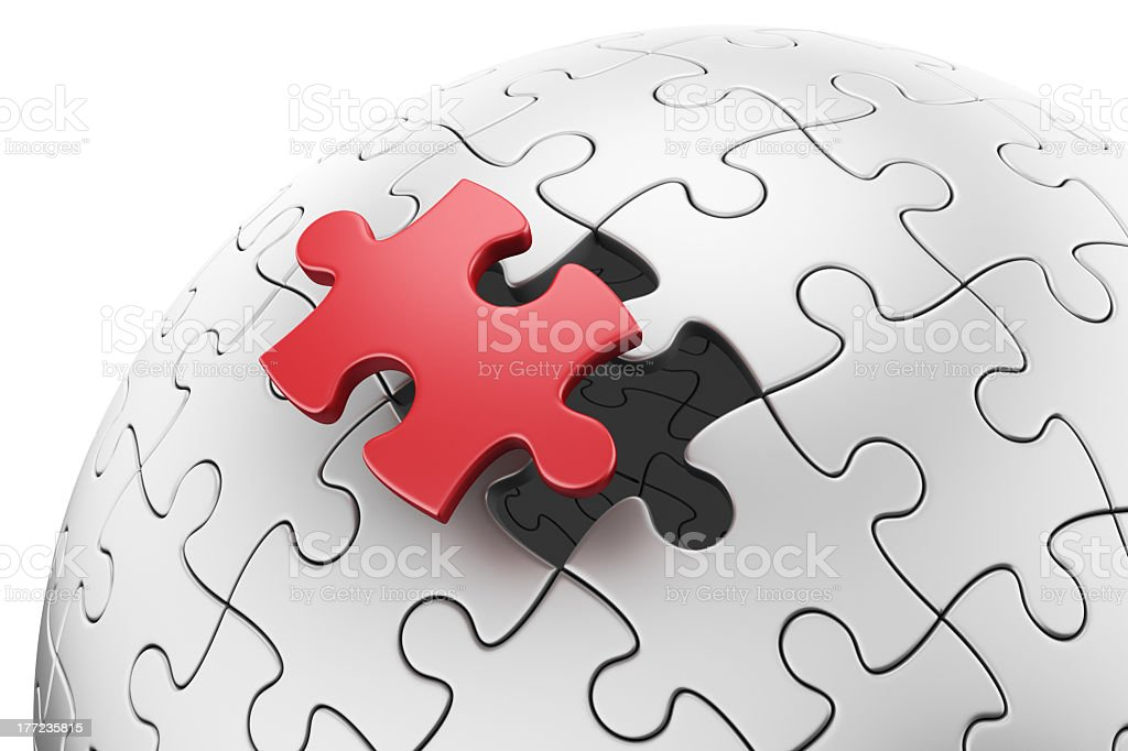 Puzzle sphere made of jigsaw with a red piece floating royalty-free stock photo