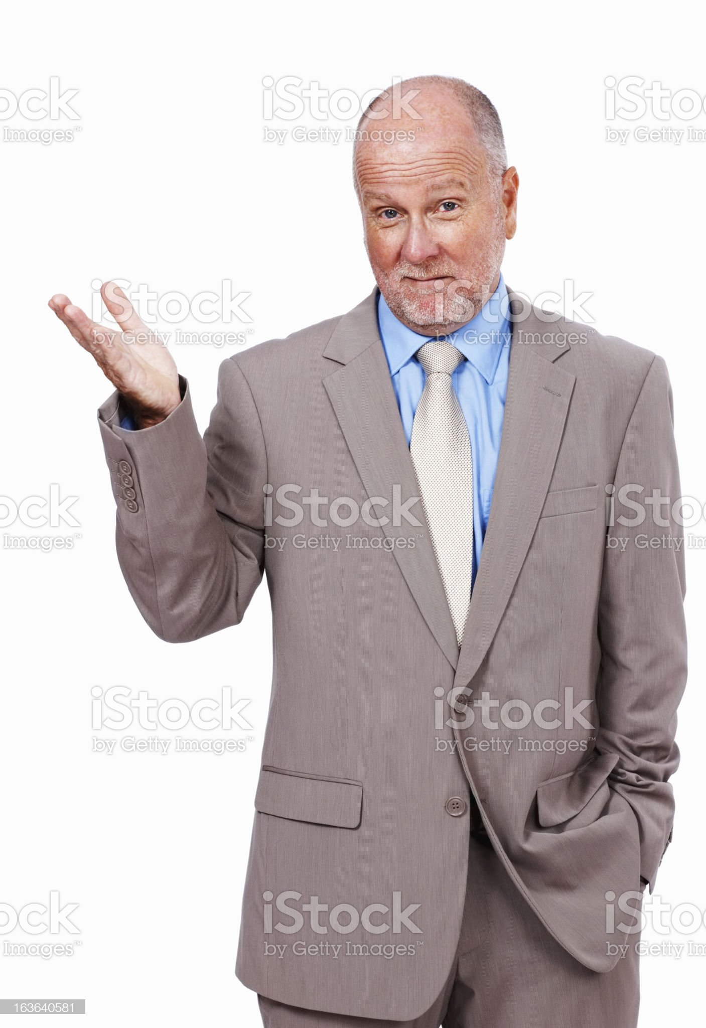 Puzzled businessman gesturing with his hand royalty-free stock photo