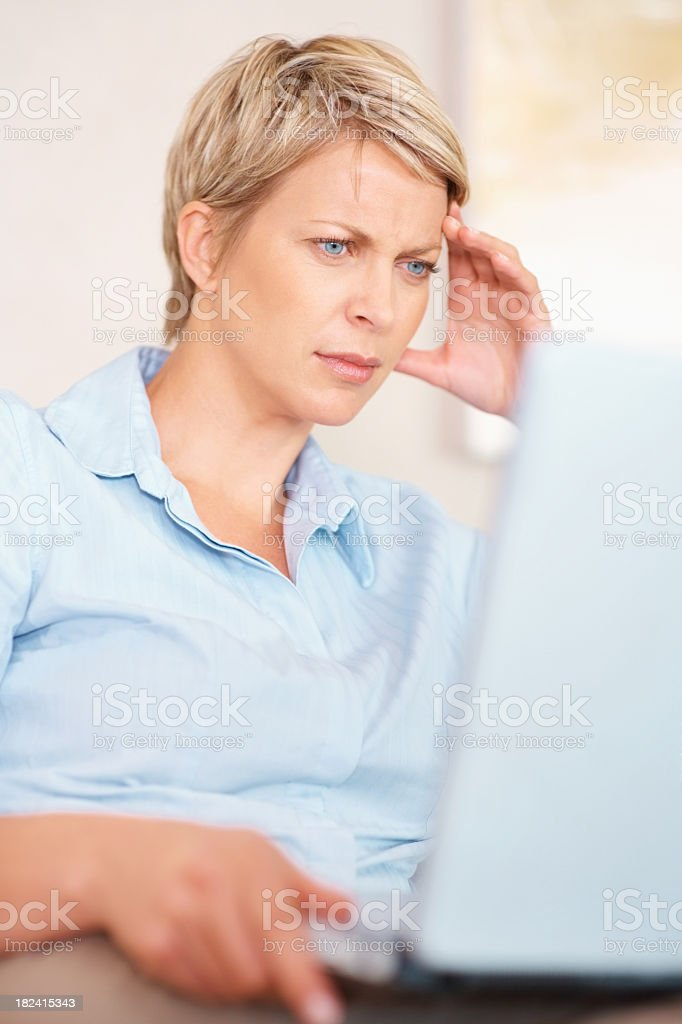 Puzzled looking  woman using a laptop royalty-free stock photo