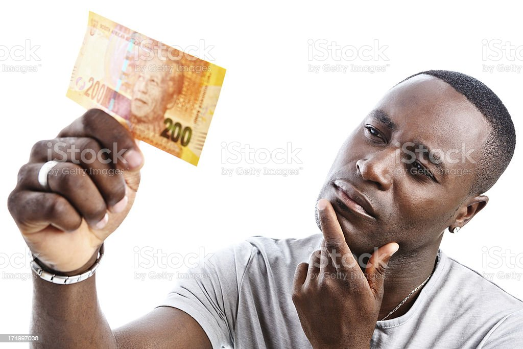 Puzzled man eyes new South African Two Hundred Rand banknote stock photo