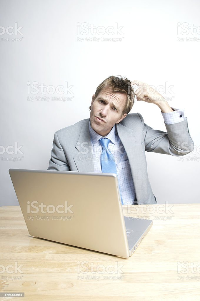 Puzzled Office Worker Scratches Head royalty-free stock photo