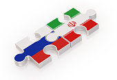 Puzzles Made with Russian and Iranian Flags ; Teamwork Concept