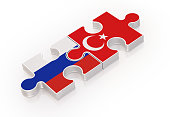 Puzzles Made with Russian and Turkish Flags ; Teamwork Concept