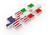 Puzzles Made with USA and Iranian Flags ; Teamwork Concept