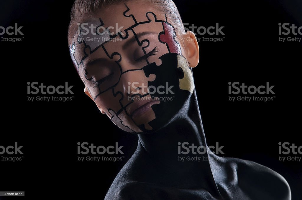 puzzles painted on face royalty-free stock photo