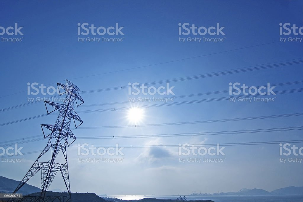 Pylon against blue sky and hazy sun stock photo