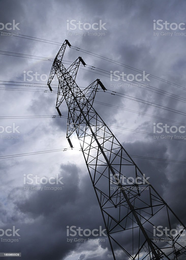 Pylon or transmission tower against a stormy sky stock photo