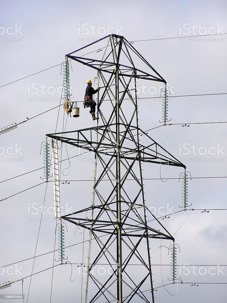Pylon worker royalty-free stock photo