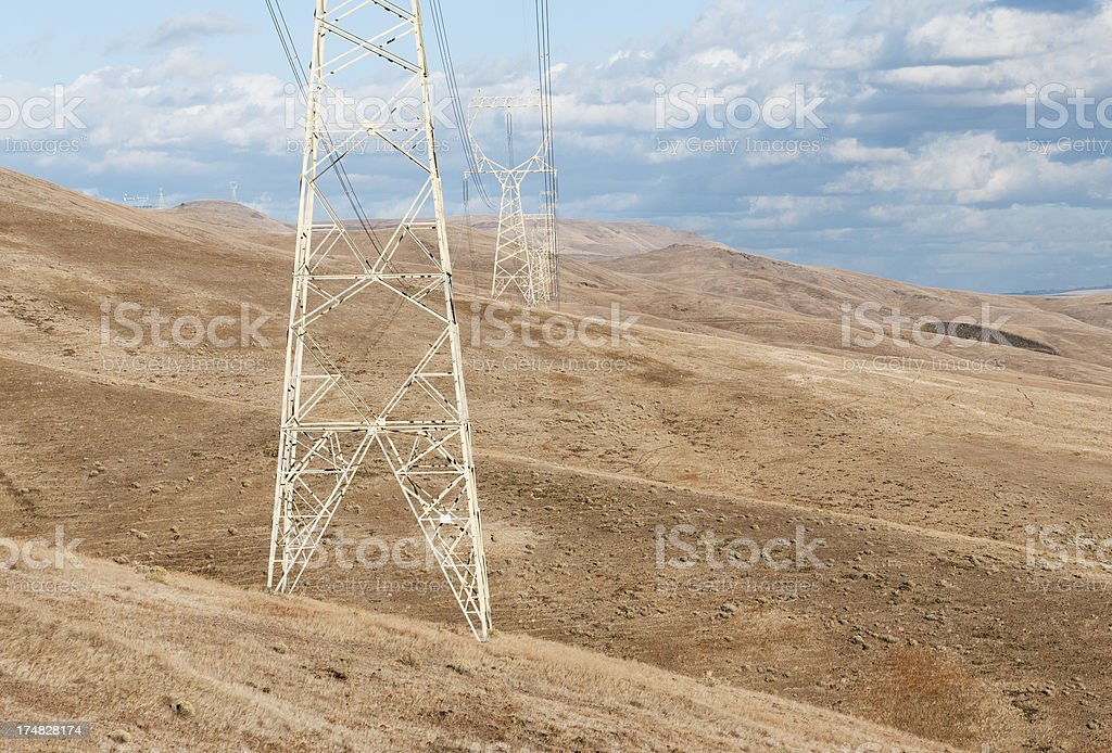 Pylons carrying hyrdoelectric cables across canyon royalty-free stock photo