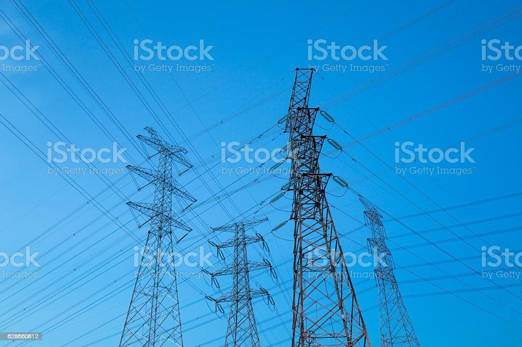 pylons in blue sky stock photo