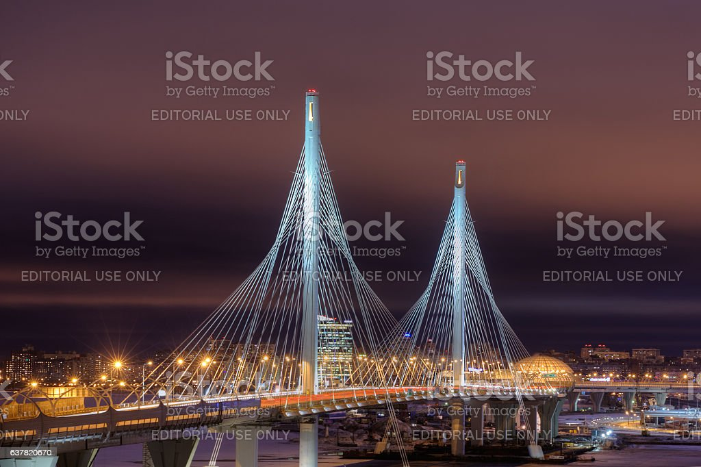 Pylons of road stayed bridge are highlighted at night, Russia. stock photo