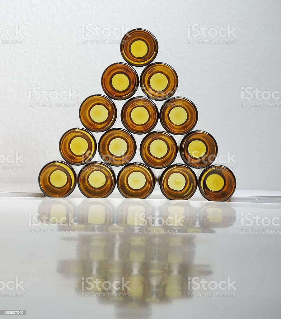 Pyramid brown glass bottle. stock photo
