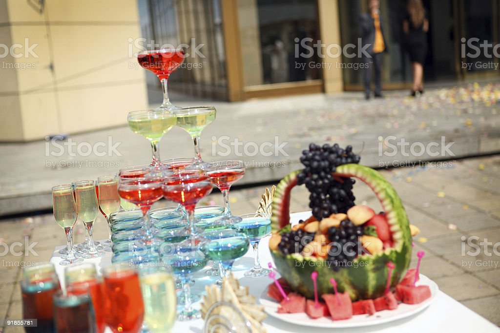 Pyramid from champagne glasses and fruit on the table outdoor. royalty-free stock photo