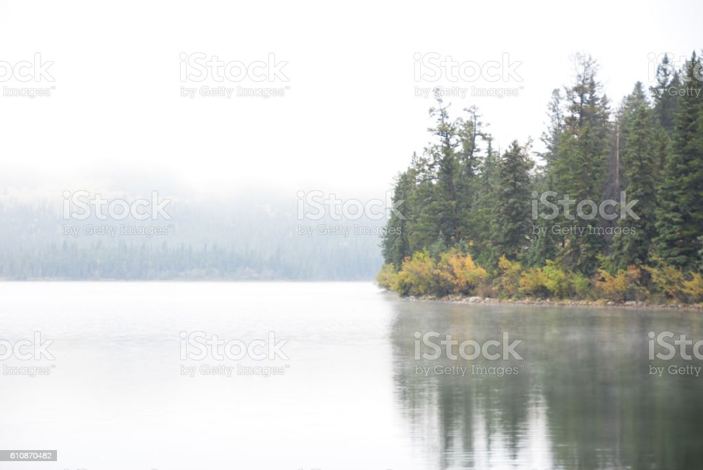 Pyramid Lake in the Morning Mist in Autumn, Canadian Rockies stock photo