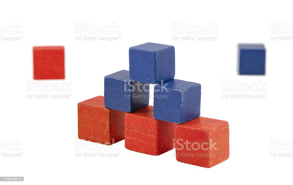 Pyramid made of wooden red blue color toy bricks royalty-free stock photo