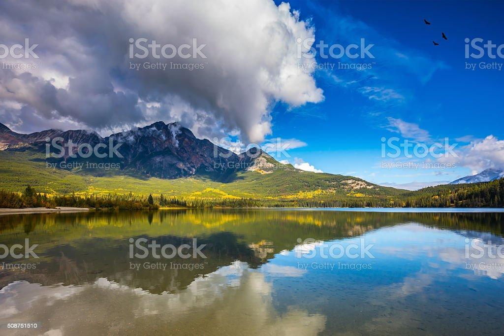Pyramid Mountain reflected in the Pyramid Lake stock photo