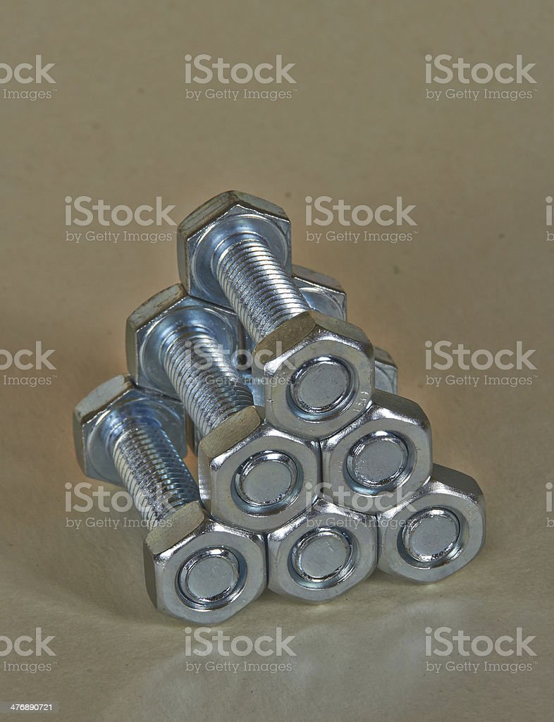 Pyramid of bolts and nuts royalty-free stock photo