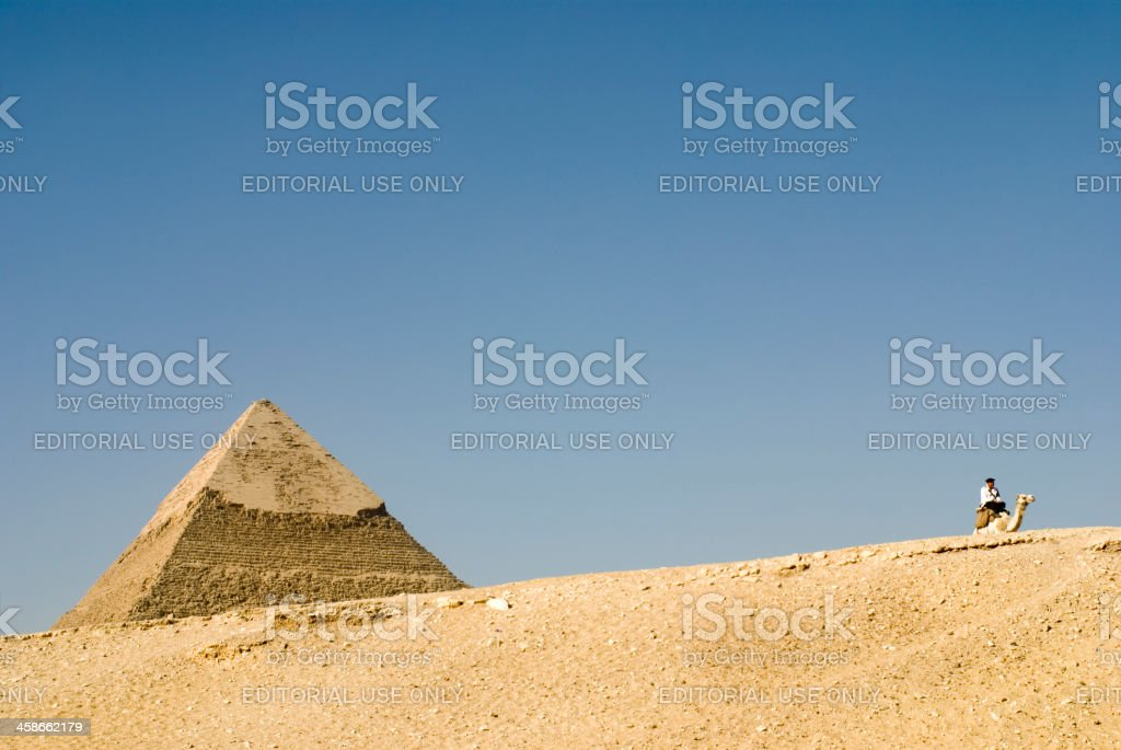 Pyramid of Chephren and policeman, Giza, Cairo, Egypt royalty-free stock photo