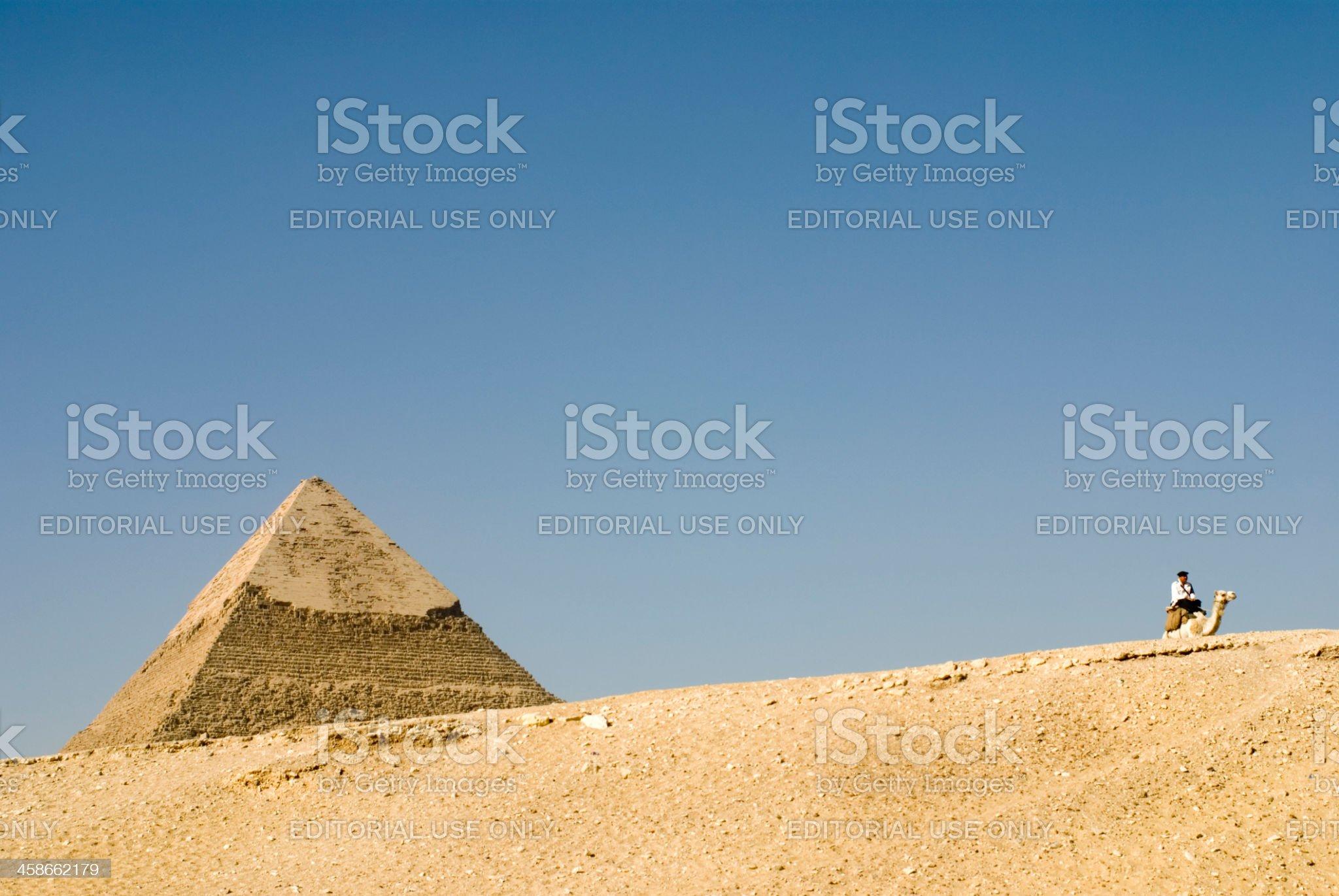 Pyramid of Chephren and policeman, Giza, Cairo, Egypt royalty-free stock photo