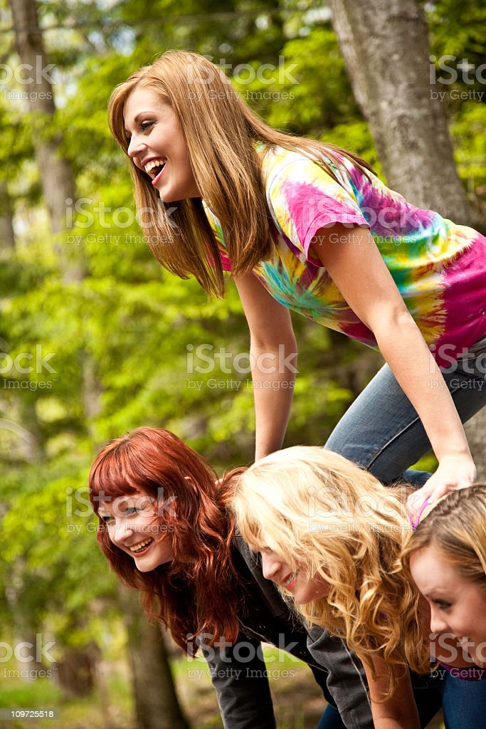 Pyramid of Happy Girl Friends royalty-free stock photo
