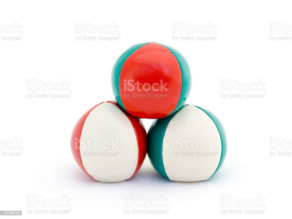 Pyramid of juggling balls stock photo