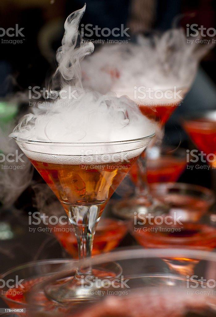 Pyramid of smoking molecular cocktails stock photo
