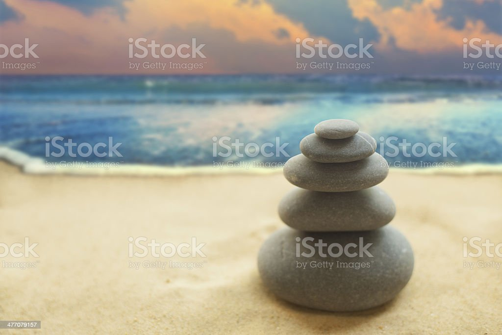 Pyramid of the stones on sandy beach royalty-free stock photo