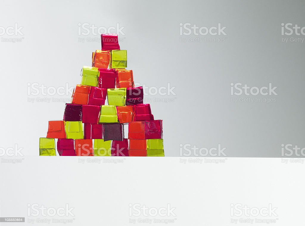 Pyramid of vibrant gelatin dessert cubes stock photo