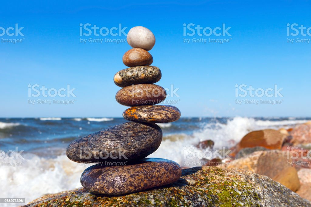 pyramid of wet stones on a background of the storm stock photo