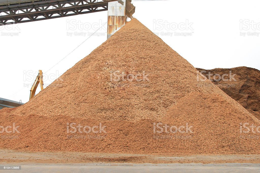 pyramid of wood chip in storage yard. stock photo