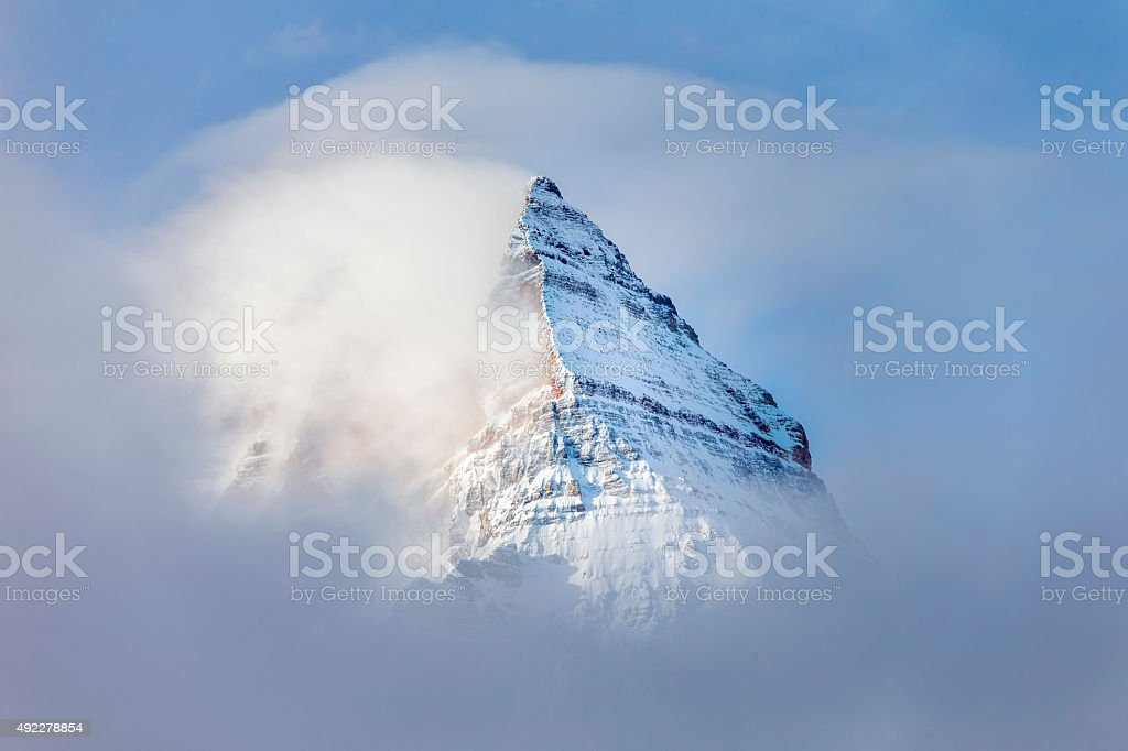 Pyramid Shaped Mount Assiniboine in the Fog stock photo