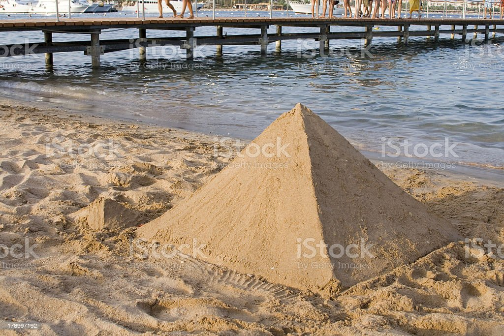 Pyramid Shaped Sand Castle royalty-free stock photo