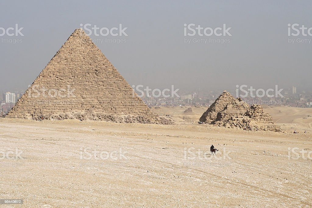 Pyramids and Cairo in background royalty-free stock photo