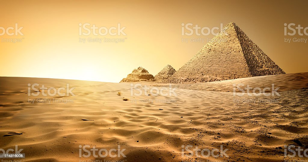 Pyramids in sand stock photo