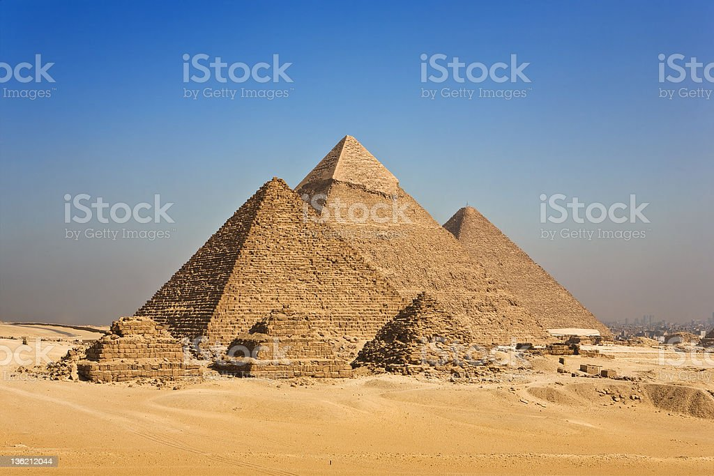 Pyramids of Giza against blue sky in Cairo, Egypt stock photo