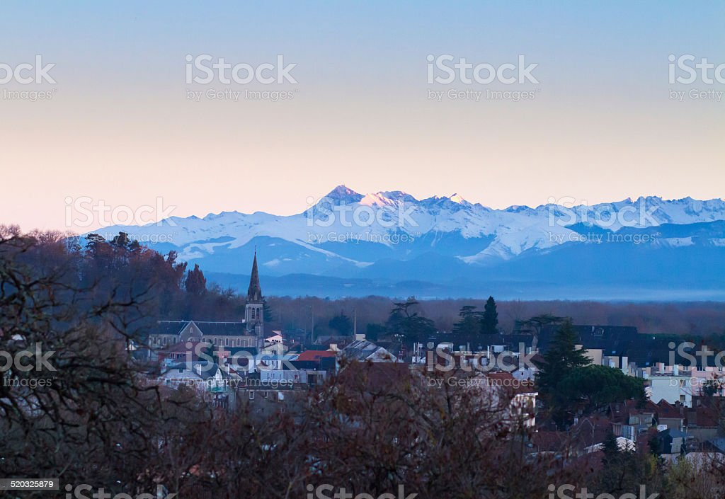 Pyrennes at sunset with Pau in foreground stock photo