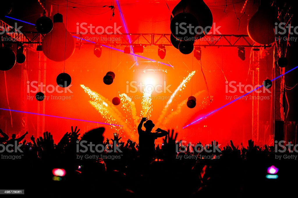 Pyrotechnics hands in the air silhouette stock photo