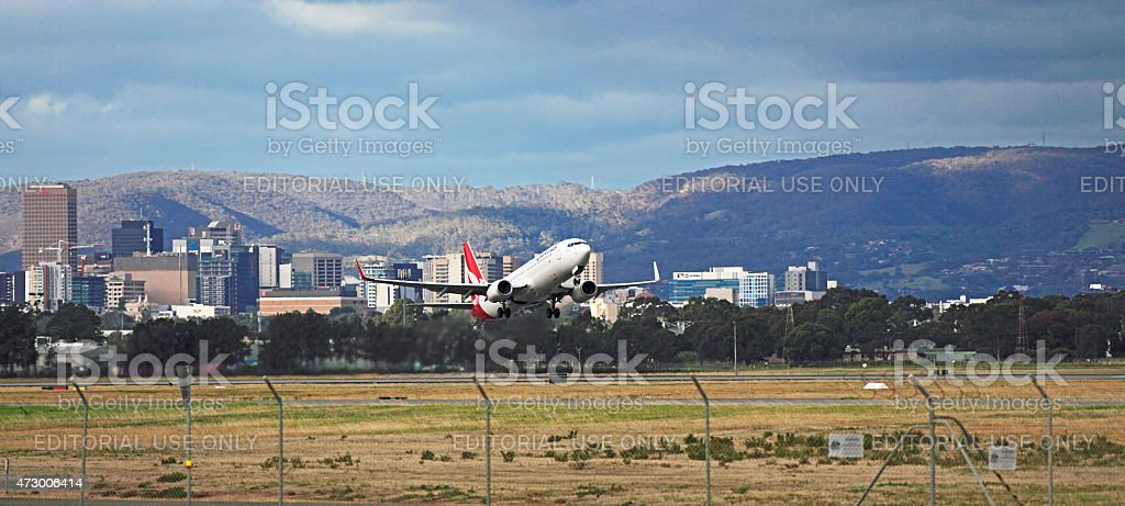 Qantas plane taking-off from Adelaide airport stock photo