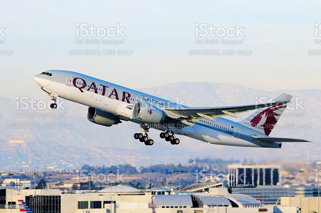 Qatar Airways Boeing 777-200LR taking off at LAX Airport stock photo