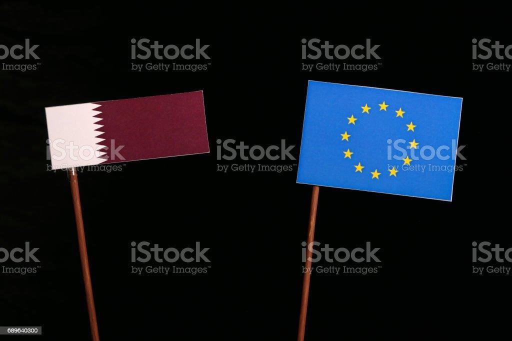Qatar flag with European Union (EU) flag isolated on black background stock photo