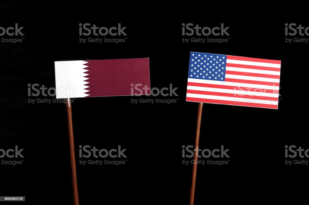 Qatar flag with USA flag isolated on black background stock photo
