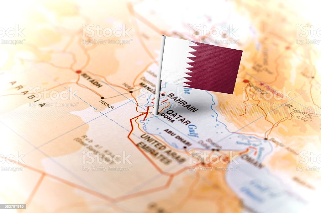 Qatar pinned on the map with flag stock photo