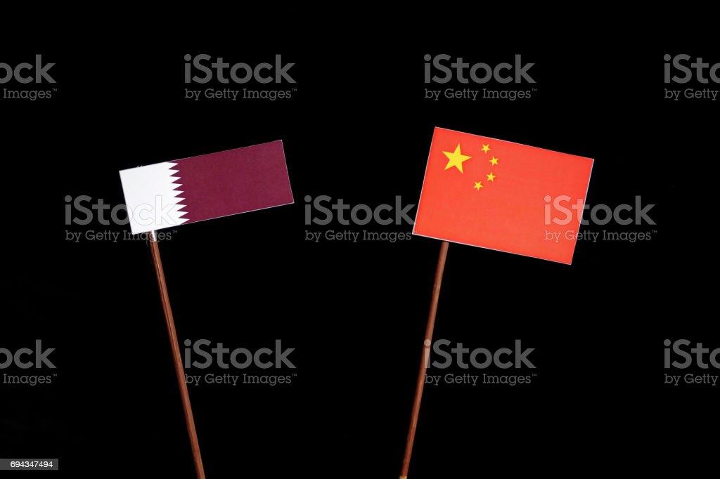 Qatari flag with Chinese flag isolated on black background stock photo