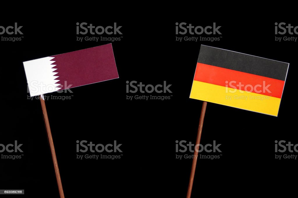 Qatari flag with German flag isolated on black background stock photo