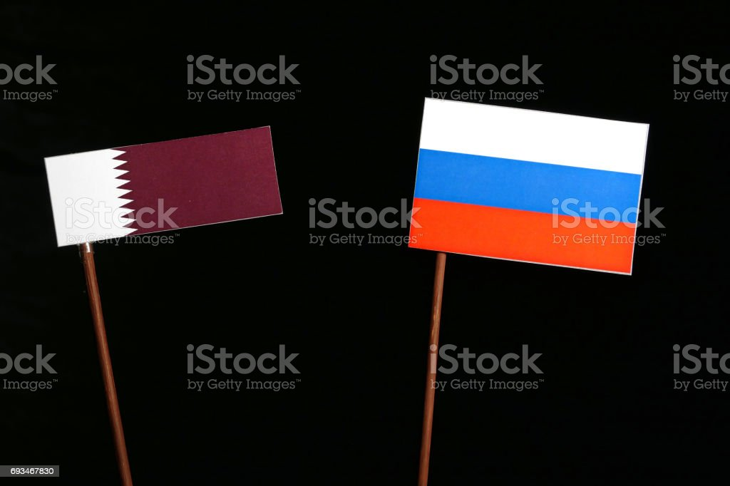 Qatari flag with Russian flag isolated on black background stock photo