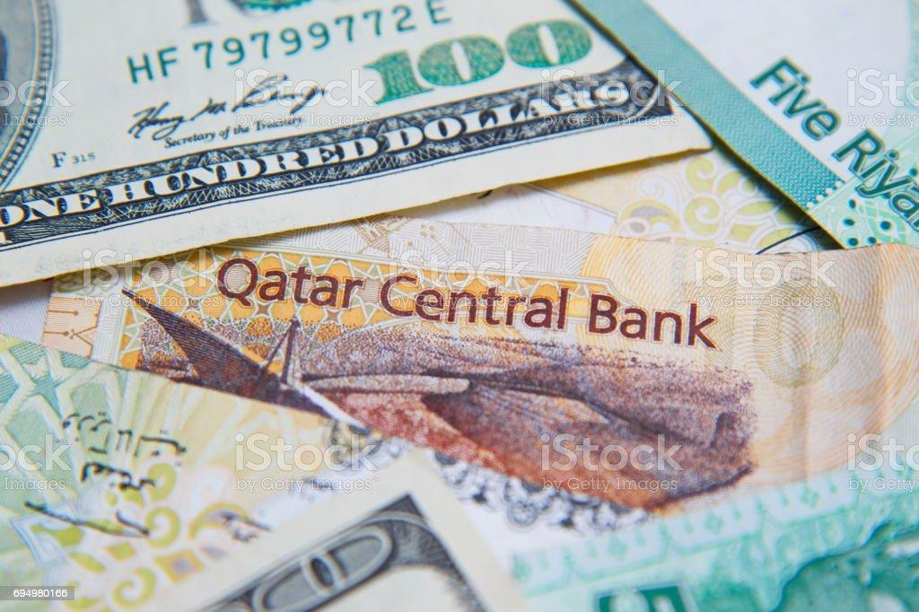 Qatari riyals and American dollars, close up stock photo