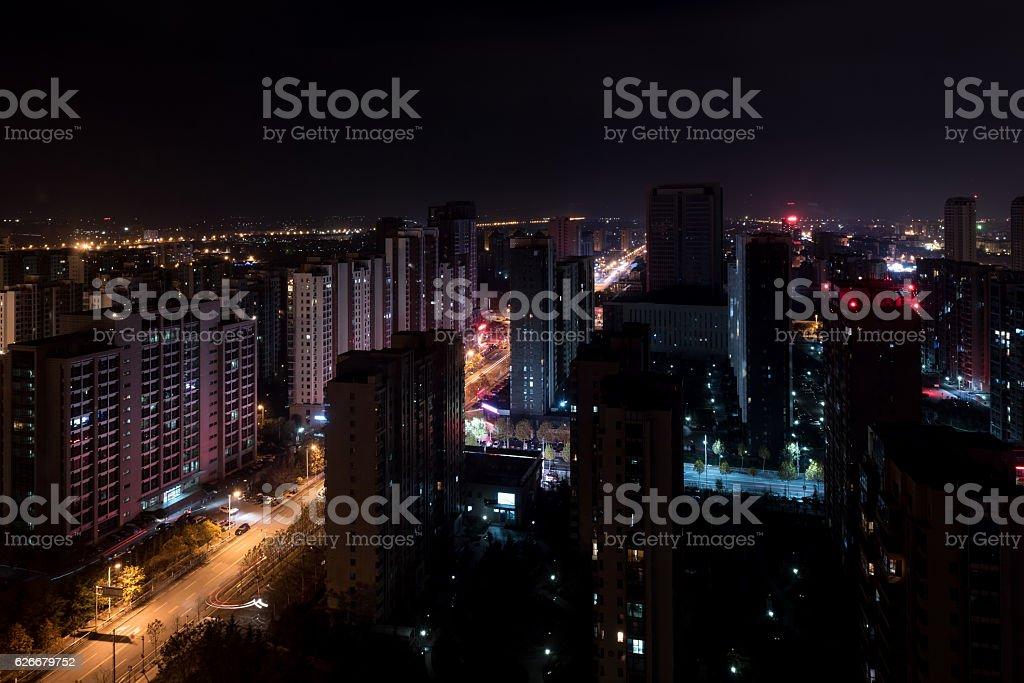 Qingdao city skyscrapers by night stock photo